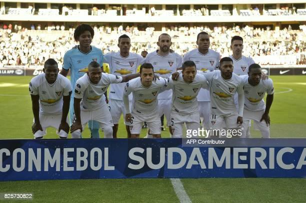 Ecuador's Liga de Quito players pose before their 2017 Copa Sudamericana football match against Bolivian Bolivar at Casa Blanca stadium in Quito on...