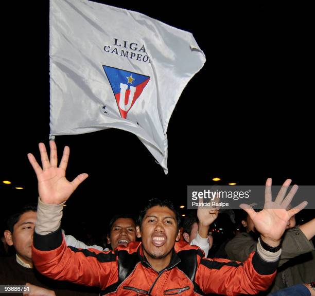 Ecuador's Liga Deportiva Universitaria's fans celebrate after winning a Copa Nissan Sudamericana against Brazil's Fluminense on December 02 2009 in...