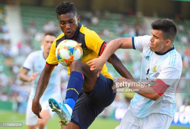 Ecuador's midfielder Jose Cifuentes vies with Argentina's midfielder Marcos Acuna during the International Friendly football match Argentina against...