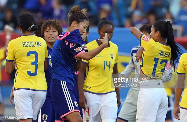Ecuador's midfielder Madelin Riera and Japan's forward Yuki Ogimi exchange jersey at the end of during their Group C football match of the 2015 FIFA...