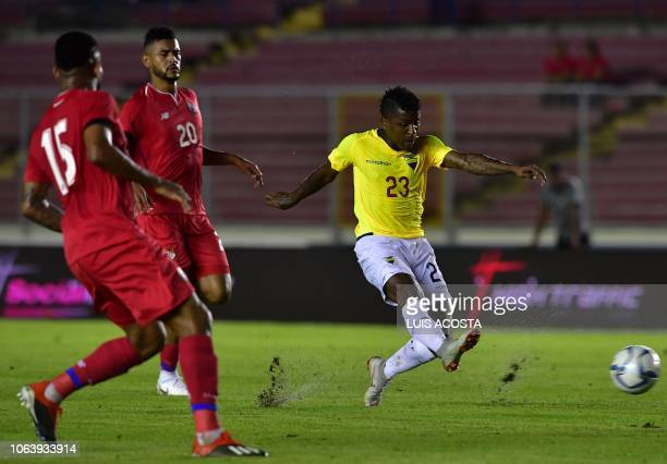 Ecuador's Miller Bolaños strikes the ball as Panama's Anibal Godoy and Eric Davis look on during their friendly football match at the Rommel...