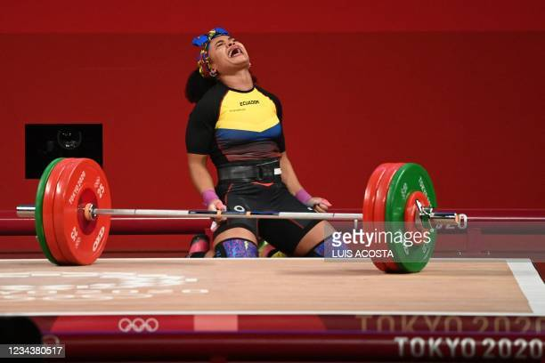 Ecuador's Neisi Patricia Dajomes Barrera reacts as she competes in the women's 76kg weightlifting competition during the Tokyo 2020 Olympic Games at...