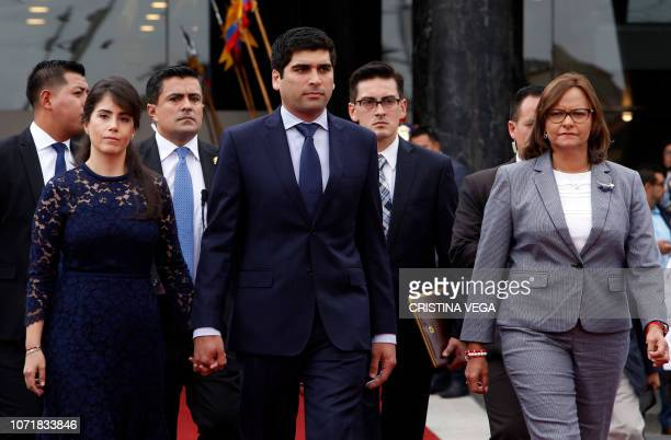 Ecuador's new Vice President Otto Sonnenholzner leaves the Congress in Quito accompanied by his wife Claudia Salem and the president of the National...