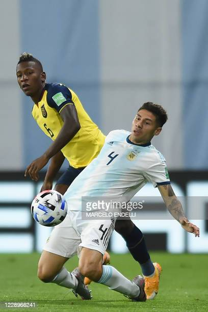 Ecuador's Pervis Estupinan and Argentina's Gonzalo Montiel vie for the ball during their 2022 FIFA World Cup South American qualifier football match...