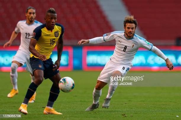 Ecuador's Pervis Estupinan and Uruguay's Nahitan Nandez vie for the ball during their 2022 FIFA World Cup South American qualifier football match at...