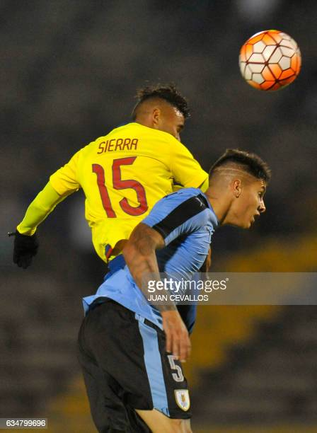 Ecuador's player Jordan Steeven Sierra jumps for the ball with Uruguay's Mathias Olivera during their South American Championship U20 football match...