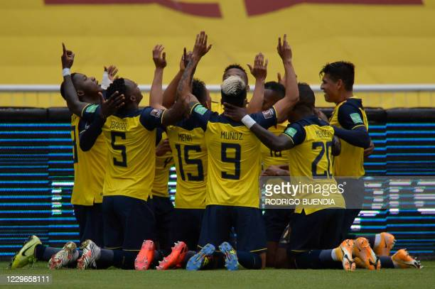 Ecuador's players celebrates after scoring against Colombia during their closed-door 2022 FIFA World Cup South American qualifier football match at...