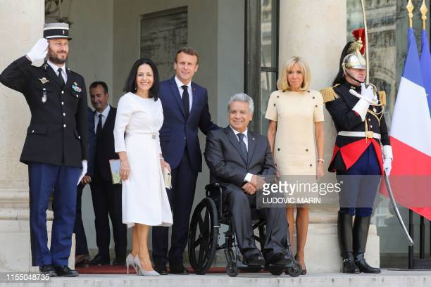 Ecuador's President Lenin Moreno and his wife Rocio Gonzalez French President Emmanuel Macron and his wife Brigitte Macron pose for a picture after a...