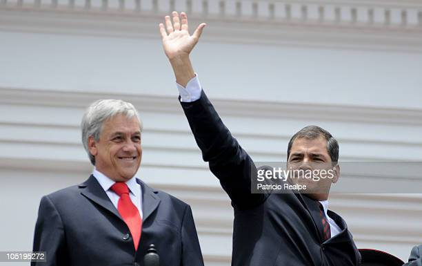 Ecuador's President Rafael Correa accompanied by his Chilean counterpart Sebastian Pinera gestures during a military ceremony at the government...