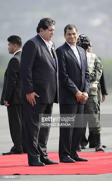 Ecuador's President Rafael Correa receives his Peruvian counterpart Alan Garcia at Catamayo airport in Ecuador on October 26 before a meeting in Loja...
