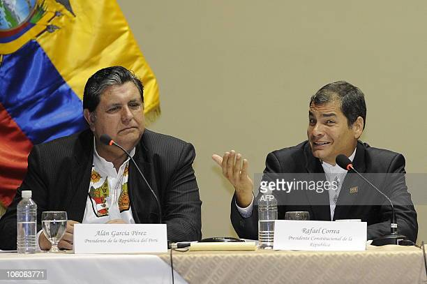 Ecuador's President Rafael Correa speaks next to his Peruvian counterpart Alan Garcia during the IV Binational Meeting in the city of Loja, on...