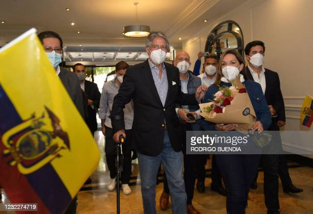 Ecuador's President-elect Guillermo Lasso arrives with his wife Maria de Lourdes Alcivar to offer a press conference at a hotel in Quito on April 12...