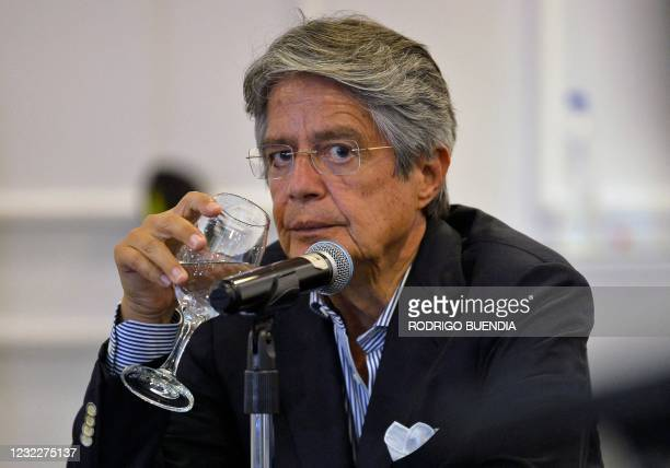 Ecuador's President-elect Guillermo Lasso looks on during a press conference with the foreign presss at a hotel in Quito on April 12 a day after the...