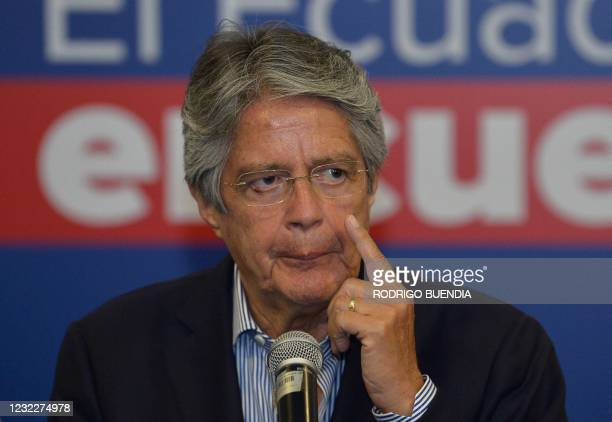 Ecuador's President-elect Guillermo Lasso offers a press conference at a hotel in Quito on April 12 a day after the run-off election. - Lasso on...