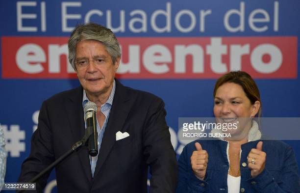 Ecuador's President-elect Guillermo Lasso offers a press conference next to his wife Maria de Lourdes Alcivar, at a hotel in Quito on April 12 a day...