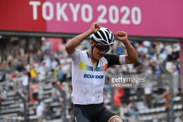 Ecuador's Richard Carapaz celebrates after crossing the finish line to win the men's cycling road race during the Tokyo 2020 Olympic Games at the...