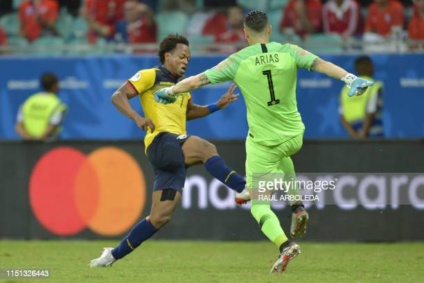 Ecuador's Romario Ibarra is fouled by Chile's goalkeeper Gabriel Arias during their Copa America football tournament group match at the Fonte Nova...