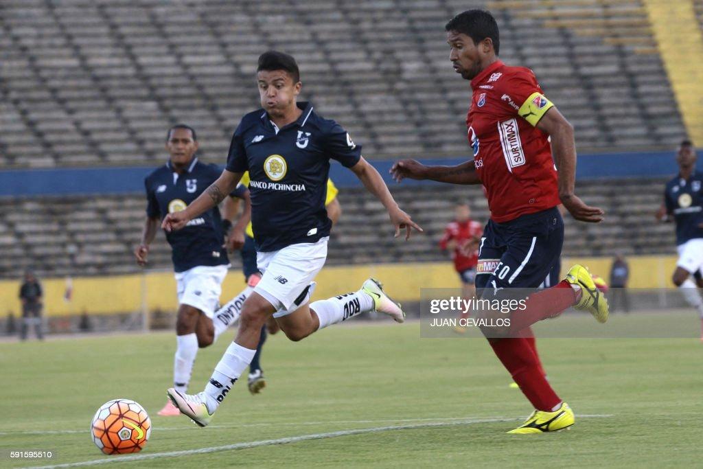 Ecuadors Universidad Catolica player Marcos Andrés López (L) vies ...