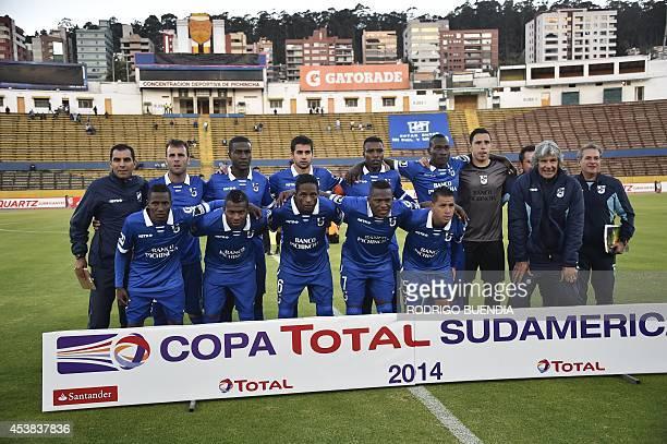 Ecuador's Universidad Catolica players pose for photographers before their 2014 Copa Sudamericana football match against Venezuela's Deportivo...