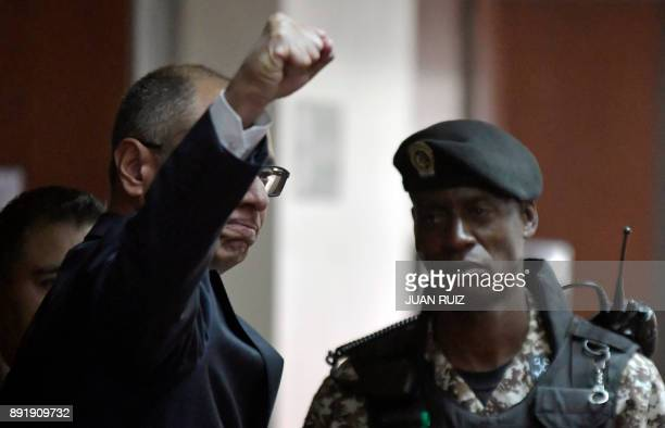Ecuador's vice president Jorge Glas gestures upon arrival at the National Court of Justice for the sentencing hearing in Quito Ecuador on December 13...