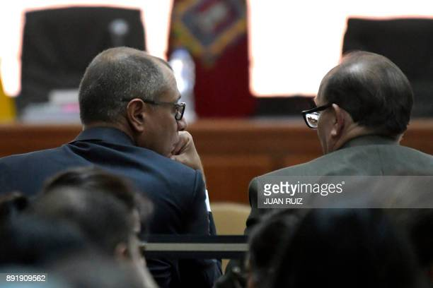 Ecuador's vice president Jorge Glas speaks with his lawyer Eduardo Franco Loor during his sentencing hearing at the National Court of Justice in...