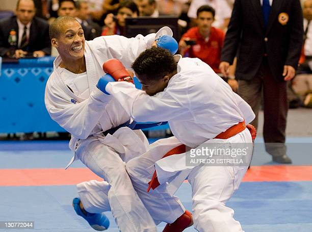 Ecuatorian Daniel Vivero and Cuban Dennis Novo fight during the karate finals of men´s under 67kg in the XVI Pan-American Games in Guadalajara,...