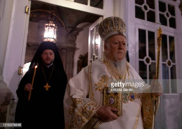 Ecumenical patriarch Bartholomew I , spiritual leader of Greek Orthodox world attends to the Easter ceremony during curfew behind the closed doors...