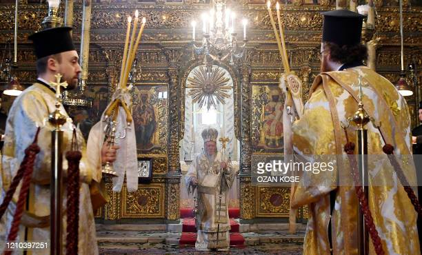 Ecumenical patriarch Bartholomew I , spiritual leader of Greek Orthodox world leads the Easter ceremony during curfew behind the closed doors...