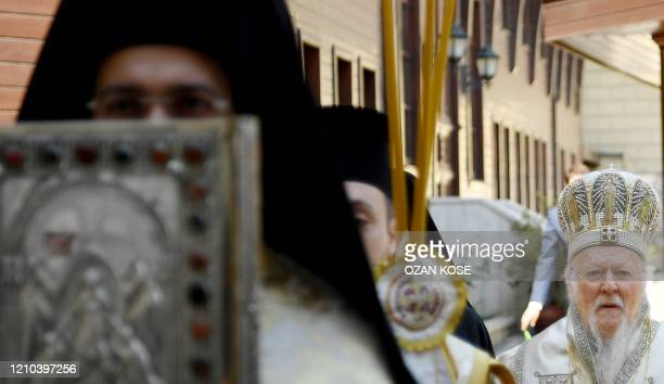 Ecumenical patriarch Bartholomew I spiritual leader of Greek Orthodox world leads the Easter ceremony during curfew behind the closed doors measures...