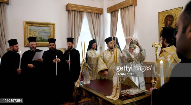 Ecumenical patriarch Bartholomew I spiritual leader of Greek Orthodox world prepares himself before leading the Easter ceremony during curfew behind...