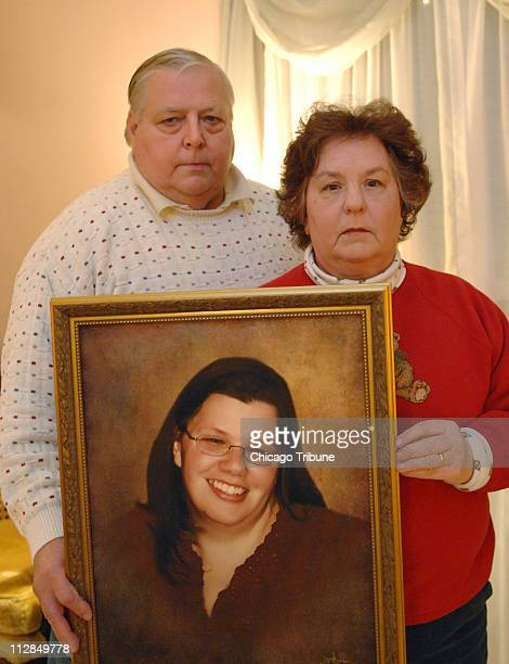Ed and Judy Richter, right, of Geneva, Illinois, hold a portrait of their daughter, Lisa, at their home, December 18, 2009. Lisa was killed last...