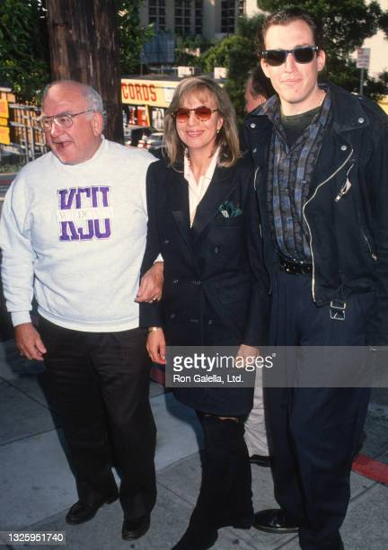 """Ed Asner and Cindy Gilmore attend """"Howard Stern Show"""" Taping at Spago Restaurant in West Hollywood, California on November 23, 1992."""
