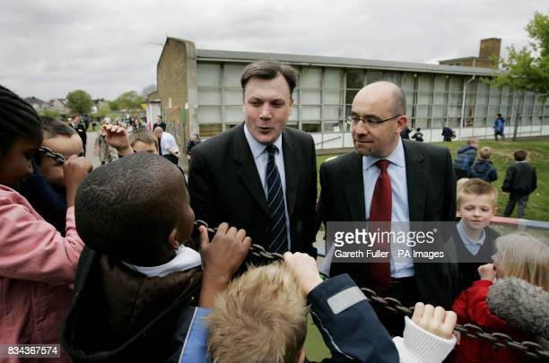 Ed Balls Secretary of State for Children Schools and Families and Jim Knight Minister of State for Schools and Learners take a walk in the playground...