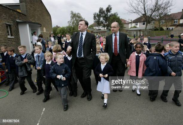 Ed Balls Secretary of State for Children Schools and Families accompanied by Jim Knight Minister of State for Schools and Learners takes walk in the...