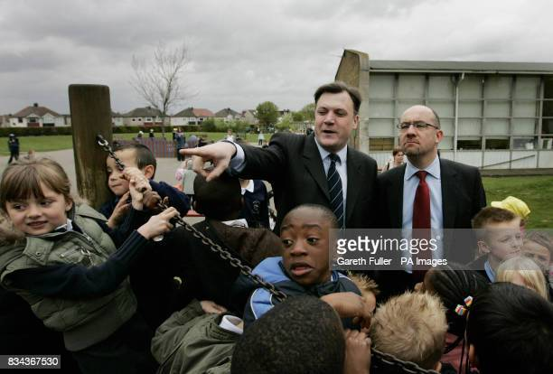 Ed Balls Secretary of State for Children Schools and Families accompanied by Jim Knight Minister of State for Schools and Learners take a walk in the...