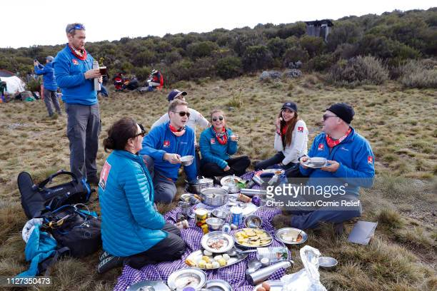 Ed Balls Shirley Ballas Dani Dyer Dan Walker Alexander Armstrong and Jade Thirlwall have some food on day 3 of 'Kilimanjaro The Return' for Red Nose...