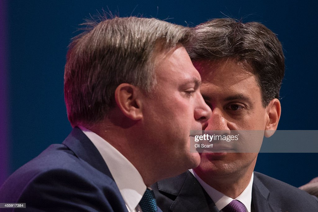 Ed Balls (L), the Shadow Chancellor of the Exchequer, and Ed Miliband, the Leader of the Labour Party, sit together on day two of the Labour Party Conference on September 22, 2014 in Manchester, England. The four-day annual Labour Party Conference takes place in Manchester and is expected to attract thousands of delegates with keynote speeches from influential politicians and over 500 fringe events.