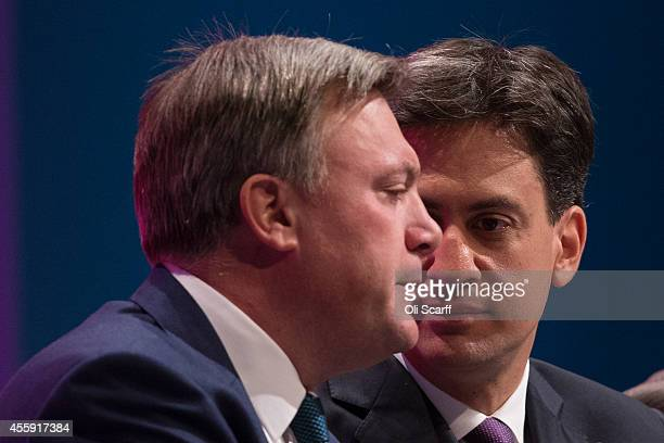 Ed Balls the Shadow Chancellor of the Exchequer and Ed Miliband the Leader of the Labour Party sit together on day two of the Labour Party Conference...