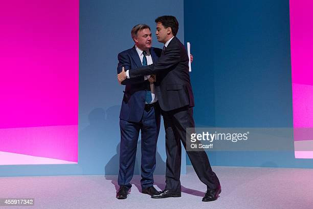 Ed Balls the Shadow Chancellor of the Exchequer is congratulated by Ed Miliband the Leader of the Labour Party after he delivered his speech to the...