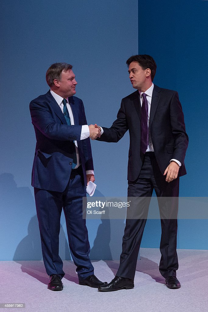 Ed Balls (L), the Shadow Chancellor of the Exchequer, is congratulated by Ed Miliband, the Leader of the Labour Party, after he delivered his speech to the Labour Party Conference on September 22, 2014 in Manchester, England. The four-day annual Labour Party Conference takes place in Manchester and is expected to attract thousands of delegates with keynote speeches from influential politicians and over 500 fringe events.