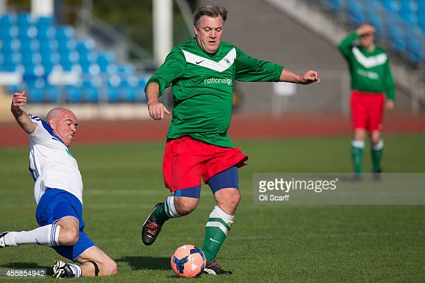 Ed Balls the Shadow Chancellor of the Exchequer plays in the annual 'Labour Party vs Journalists' football match before the start of the Labour Party...