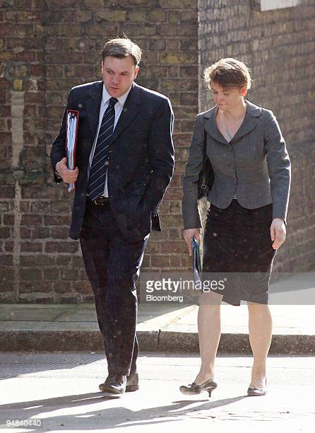Ed Balls UK education secretary left and his wife Yvette Cooper chief secretary to the Treasury arrive for the weekly cabinet meeting at number 10...