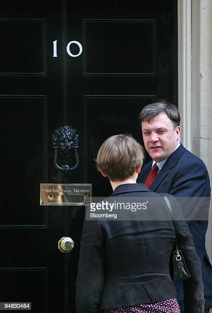 Ed Balls UK education secretary right and his wife Yvette Cooper chief secretary to the Treasury arrive for the weekly cabinet meeting at number 10...