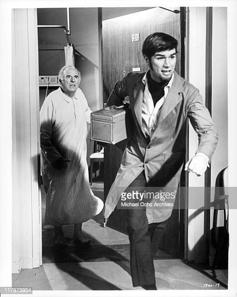 Ed Begley chases Charles Robinson in a scene from the film 'A Time to Sing' 1968