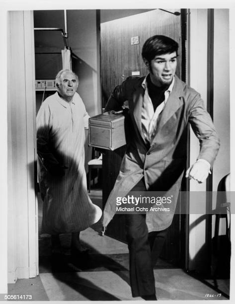 Ed Begley chases Charles Robinson out of his hospital room in a scene from the movie A Time to Sing circa 1968