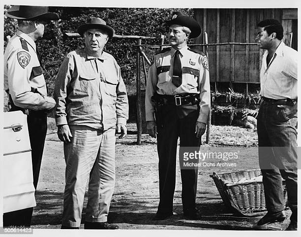 Ed Begley is stopped by policemen after running away from the hospital in a scene from the movie A Time to Sing circa 1968