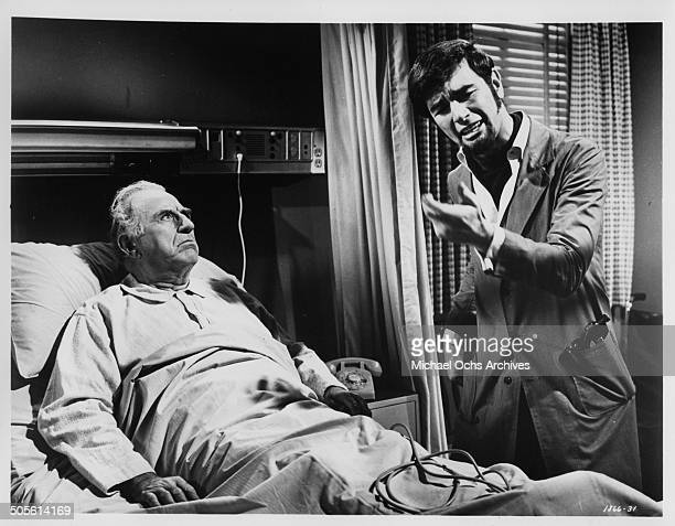 Ed Begley listens to Charles Robinson in the hospital room in a scene from the movie A Time to Sing circa 1968