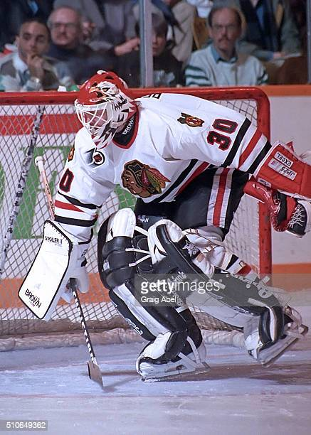 Ed Belfour of the Chicago Black Hawk stops a shot against the Toronto Maple Leafs during game action on February 29 1992 at Maple Leaf Gardens in...