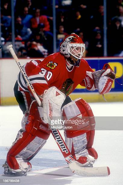 Ed Belfour of the Chicago Black Hawks in position during a hockey game against the Washington Capitals on January 8 1994 at USAir Arena in Landover...