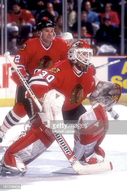 Ed Belfour of the Chicago Black Hawks in position during a hockey game against the Washington Capitals on March 8 1994 at USAir Arena in Landover...